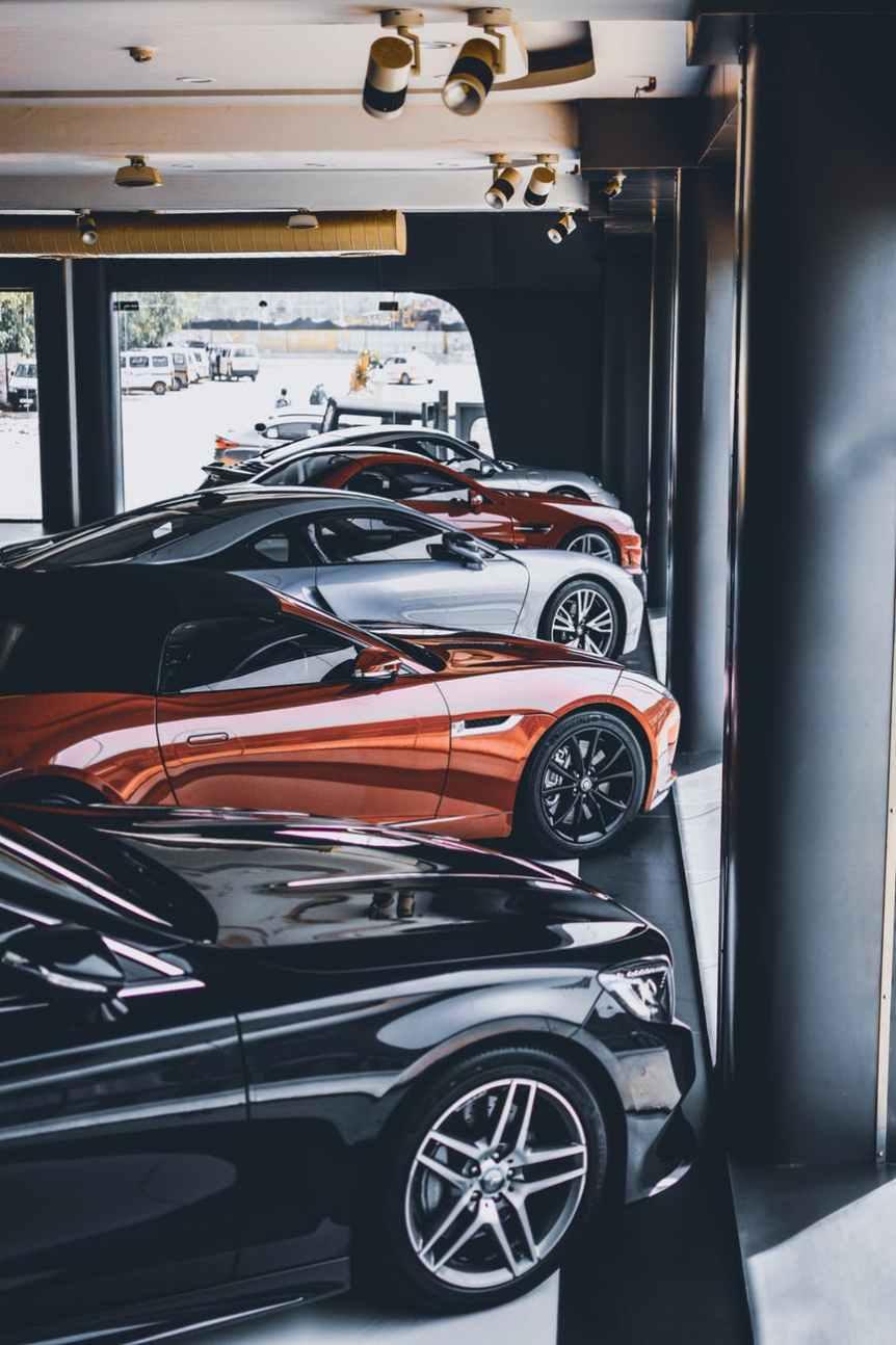 five assorted color cars parked inside room