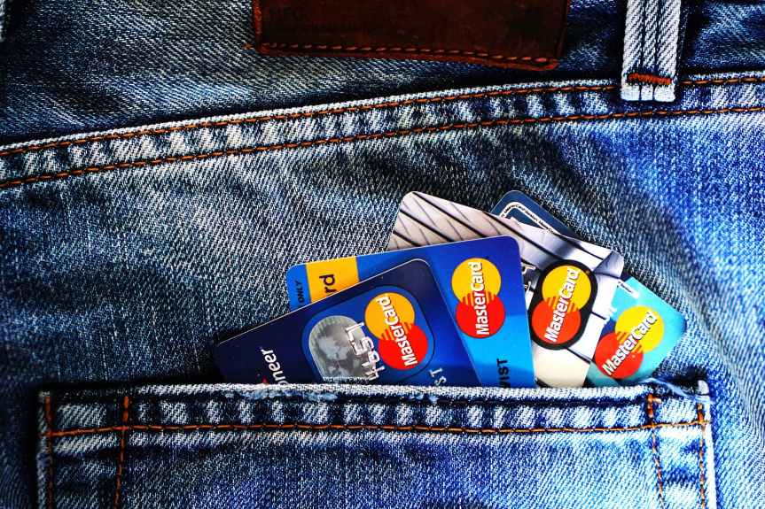 blue master card on denim pocket
